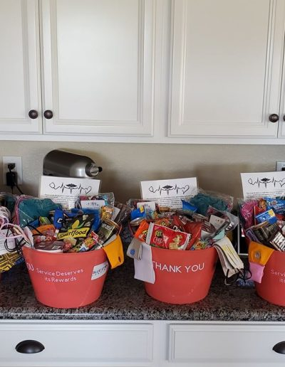 Blue Star Lending Bucket full of Giveaways to the heroes in Sacramento, California